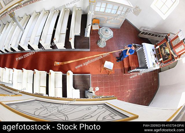 28 August 2020, Saxony, Kossa: After the ringing of the bells of the small church in Kossa, the 18-year-old Janus Deutrich can use the renovated church room for...