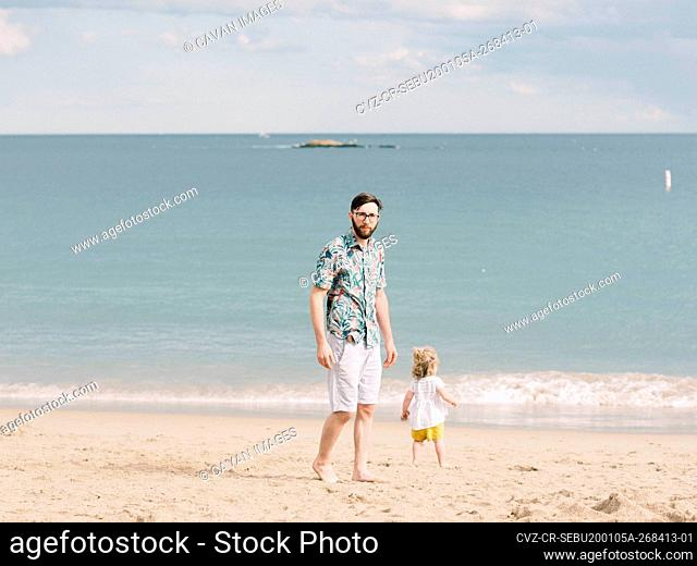 Father and daughter duo during vacation on the beach