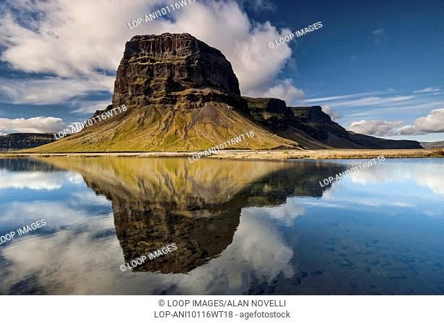 Perfect reflection of the dramatic escarpment of Mount Lomagnupur