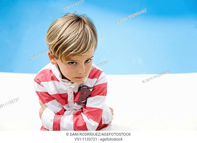 Young kid angry beside a Pool