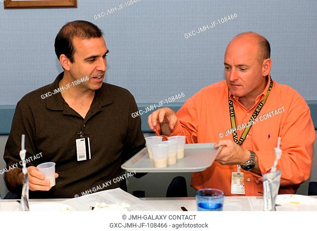 Astronauts Richard A. (Rick) Mastracchio (left), STS-118 mission specialist, and Scott J. Kelly, commander, participate in food tasting in the Flight Projects...