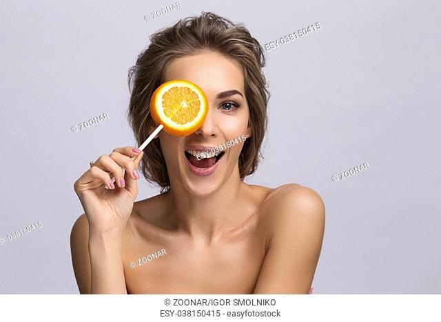 Woman with slice of orange