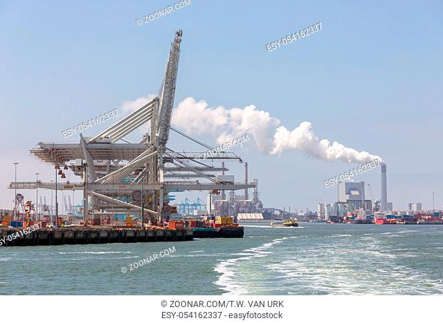 Rotterdam, The Netherlands - June 5 2018: Container terminal with big cranes ready to load and unload cargo ships in Dutch harbor Rotterdam