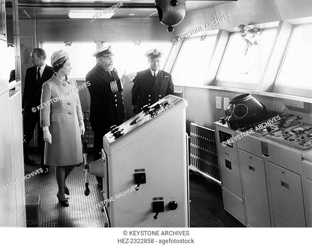 Captain William Warwick shows the Queen the bridge of the liner 'QE2', Southampton, 1969. The 'QE2' made its maiden voyage in 1969