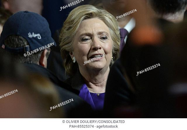 Democratic Presidential candidate Hillary Clinton greets campaign staff after delivering her concession speech Wednesday