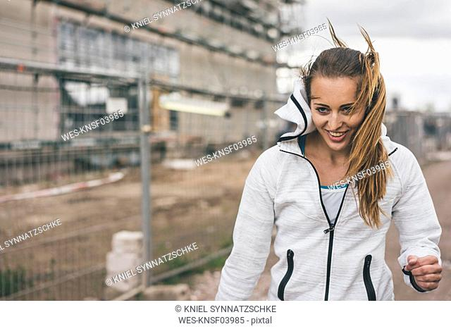 Portrait of smiling sportive young woman outdoors