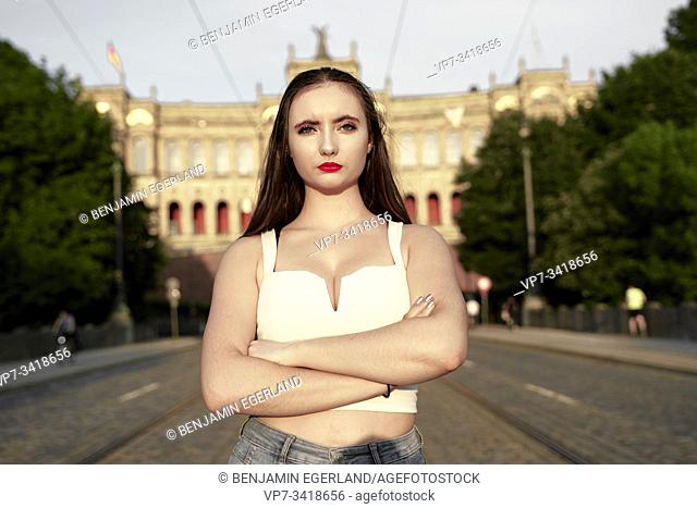 Portrait of serious young woman looking at camera. Munich, Germany
