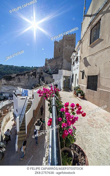 Side view of the village, on top of limestone mountain is situated Castle of the 12TH century Almohad origin, take in Alcala of the Jucar, Albacete province