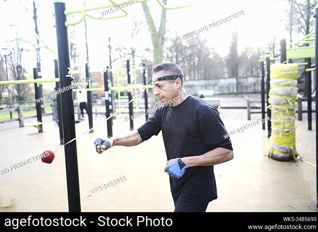 Mature man training in park. Paris, France