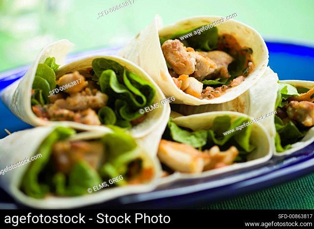 Chicken and lettuce burritos