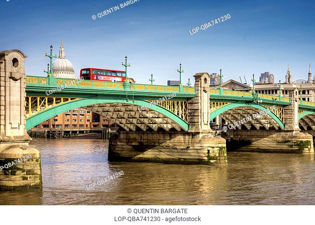 A bus travels over Southwark Bridge