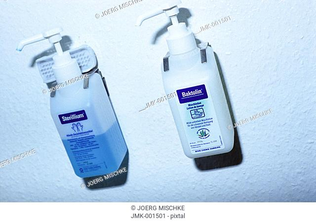 Dispenser with hand disinfection and soap