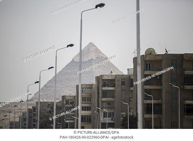 dpatop - A view of residential buildings, backdropped by the Great Pyramid of Khufu outside the Grand Egyptian Museum, in Giza, Egypt, 26 April 2018