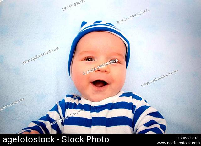 3 month old baby lying in blue blanket