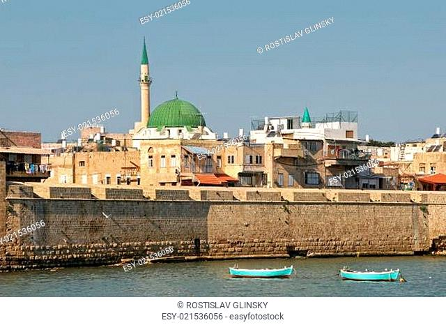 View on ancient walls, houses and mosques in old town of Acre (Akko) in Israel