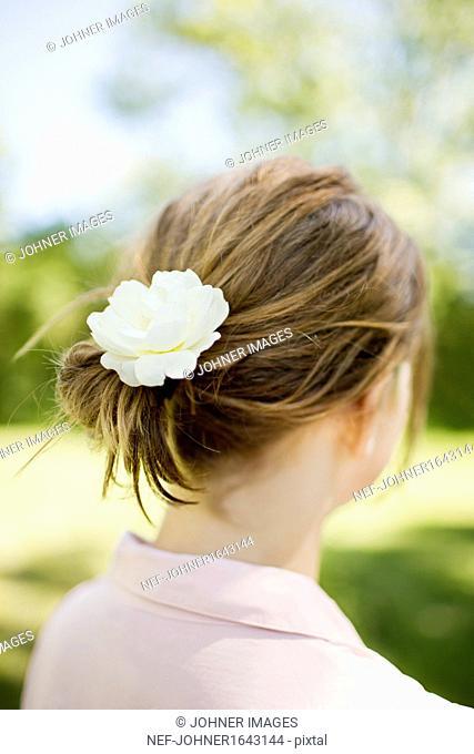 Flower in girls hair, close-up