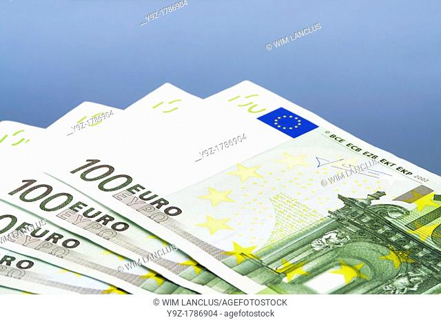 Euro Bills One Hundred on blue background