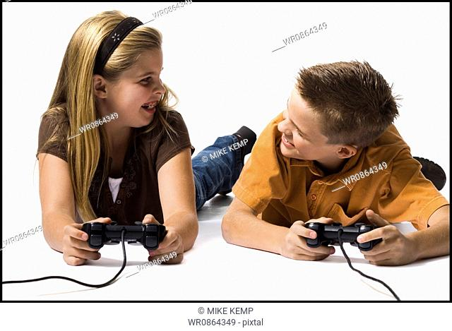 Brother and sister playing a video game