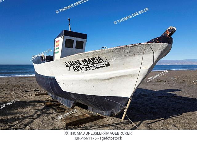 Fishing boat at the San Miguel beach, San Miguel de Cabo de Gata, Nature Reserve Cabo de Gata-Nijar, Almeria province, Andalusia, Spain