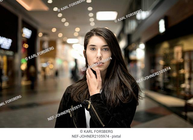 Portrait of woman in shopping center