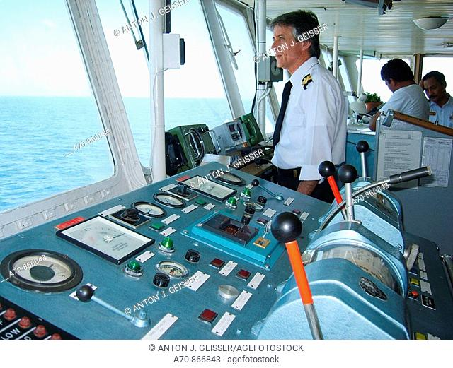 Bridge of the cruise ship Coral, captain with navigational instruments  !