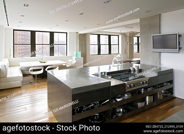 Hob set in unit in modern open plan kitchen with dining area
