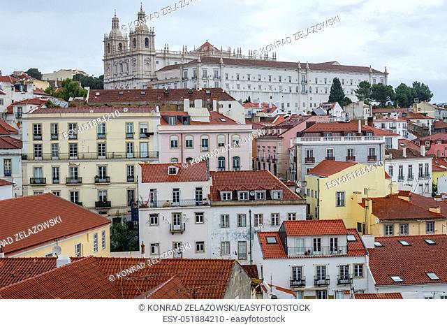 Aerial view from Miradouro das Portas do Sol in Alfama district of Lisbon city, Portugal. Monastery of Sao Vicente de Fora on background