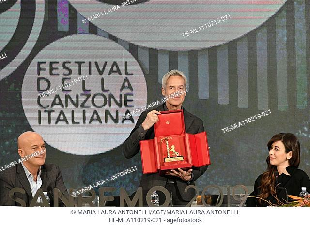 Claudio Bisio, Claudio Baglioni shows the 'Amico di Sanremo ' Award (Friend of Sanremo), Virginia Raffaele during the final press conference of 69th Sanremo...