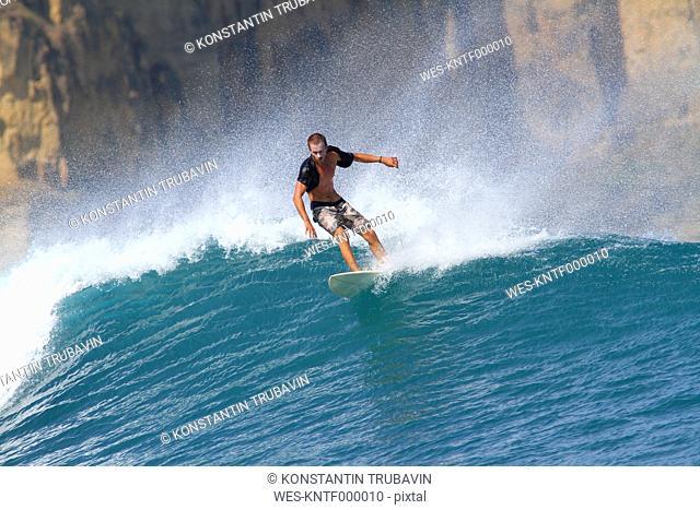 Indonesia, Lombok Island, surfing man