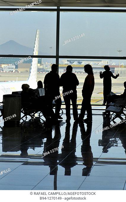 People silhouettes. Terminal T1 by Ricardo Bofill, 2009. El Prat Airport. Barcelona. Catalonia. Spain