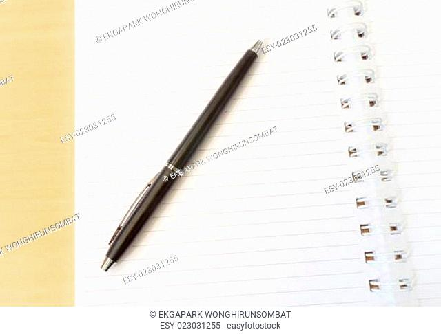 Two Pages Open Notebook with Black Pen on Wooden Surface with Idea Concept