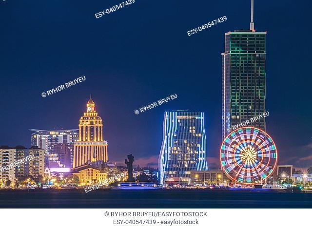 Batumi, Adjara, Georgia. Modern Architecture In Seafront Promenade. Miracle Park In Night Or Evening Illuminations Lights