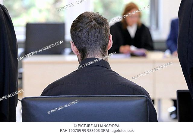 09 July 2019, Mecklenburg-Western Pomerania, Rostock: The 28-year-old defendant in the trial for attempted double homicide is waiting in the courtroom of the...
