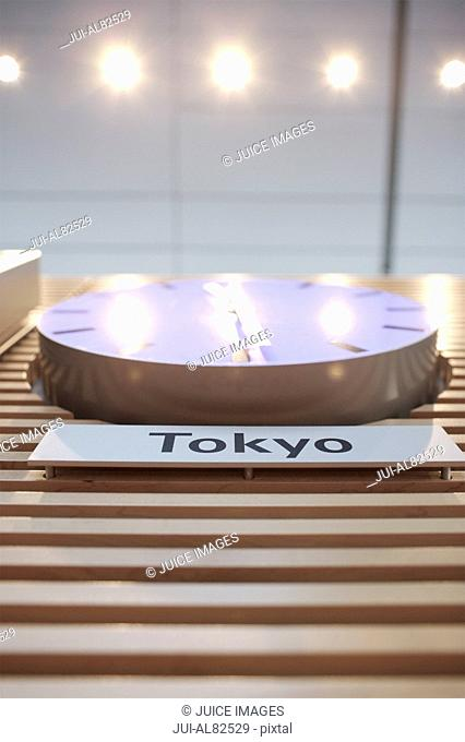 Low angle view of clock with Tokyo time