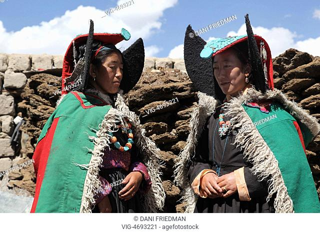 INDIA, KHARNAKLING, 08.07.2014, Ladakhi women from Kharnak wearing traditional outfits with turquoise studded perak headdresses in Kharnakling, Leh District