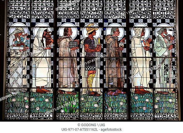 Truly I tell you. What you have done it unto one of my brothers you did it to me.' Stained glass by Koloman Moser. Steinhof Church built by Otto Wagner betweens...
