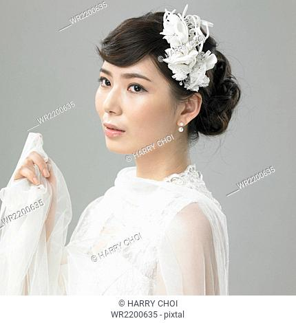 Woman in wedding dress being graceful