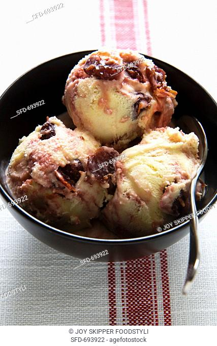 Bowl of Cherry Ripple Ice Cream with Spoon, On White and Red Dish Cloth