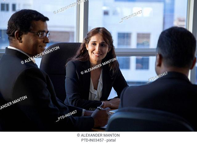 Singapore, Three smiling business people at conference table