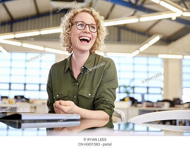 Laughing businesswoman in office