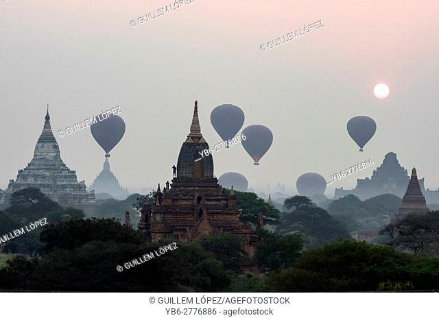 Silhoutte of Hot air Balloons flying over the temples of Bagan Historical site, Myanmar