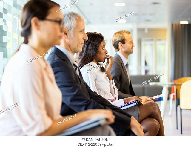 Business people sitting in office together