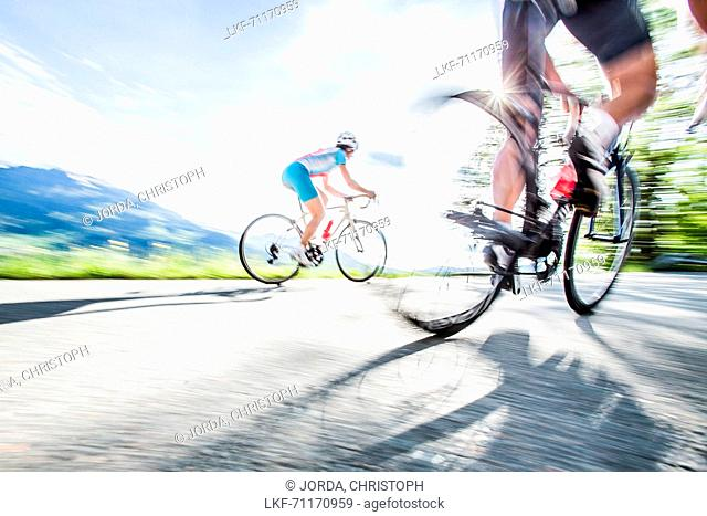 Two young people on their racing cycles in the Kitzbühler Alps, Kitzbühlerhorn, Tyrol, Austria