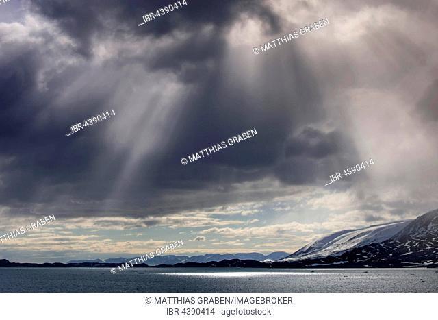 Coastline, rays of sunlight, Svalbard, Spitsbergen, Norway