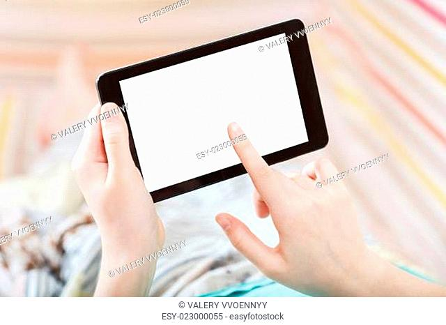 girl touching tablet pc with cut out screen