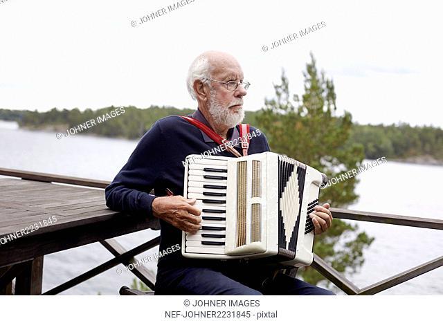 Senior man playing accordion