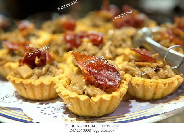 Tartlets with Jabugo ham and mushrooms. Pintxos, San Sebastian (Donostia), Basque Country, Spain