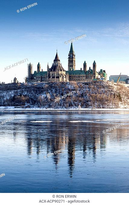 View of Parliament Hill on the banks of the Ottawa River as seen from Gatineau, Quebec, Canada