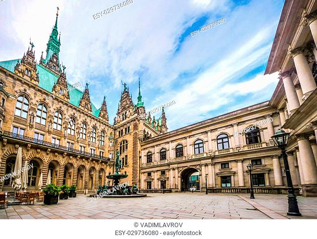 Beautiful view of famous Hamburg town hall with Hygieia fountain from courtyard near market square and lake Binnenalster in Altstadt quarter, Hamburg, Germany