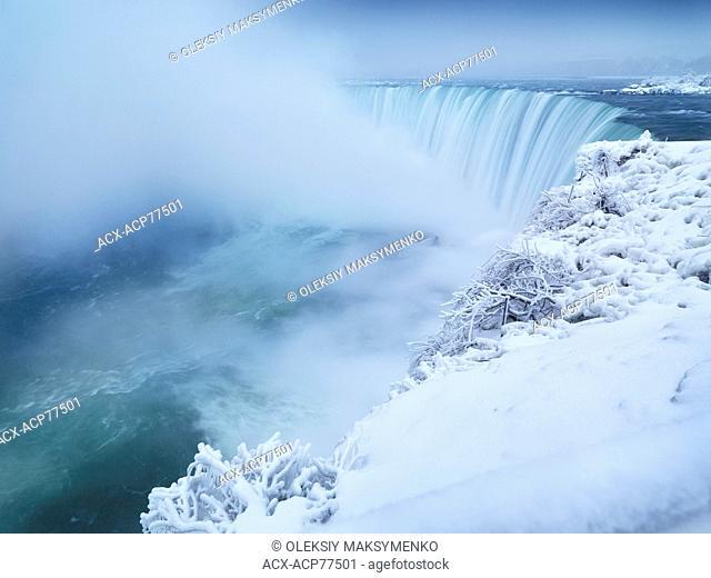 Niagara Falls Horseshoe waterfall covered with snow, wintertime scenic. Ontario, Canada
